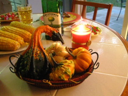 My autumn table center piece, four fall gourds, complete with matching candle.