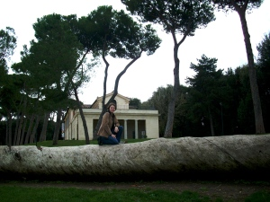 Your faithful writer sits atop a fallen umbrella pine near the outdoor hippodrome in Villa Borghese park