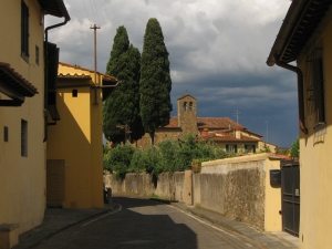 Cypresses rise from behind every garden wall in here in the hills above Florence