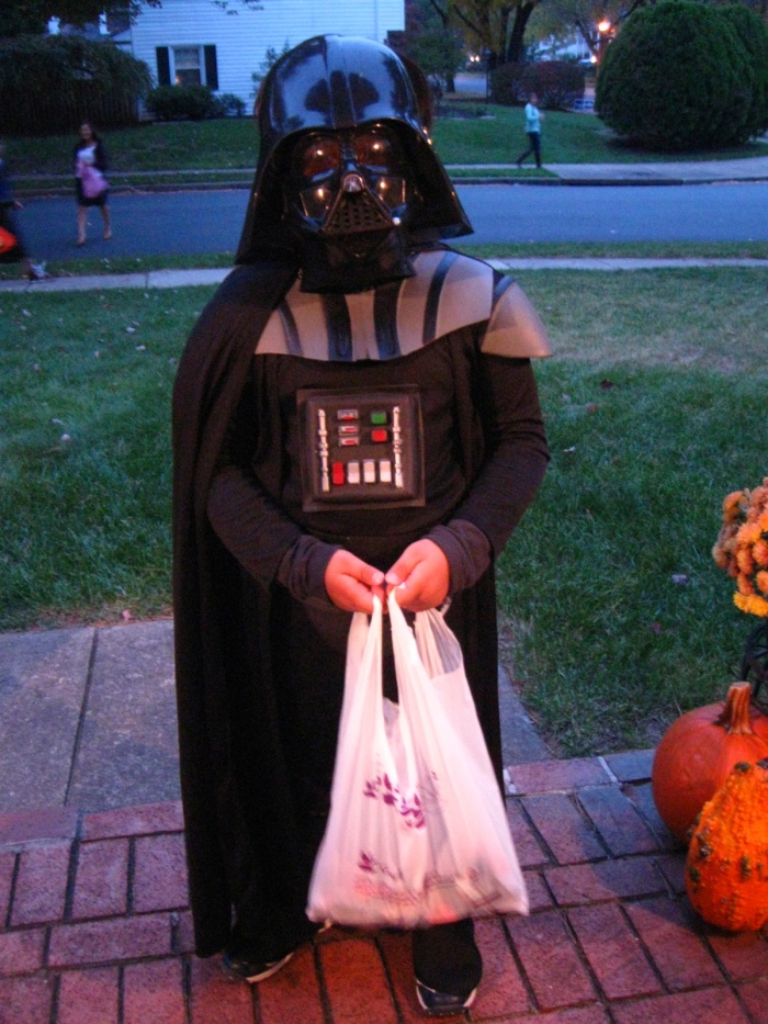 Darth Vader was one of the very first to ring my bell, before dusk had even properly fallen. He knows that the early Sith Lord gets  first pick of the Halloween spoils. Actually, this kid was out with his friends and their parents collecting donations of canned food for a local charity. Well, we all knew he came back from the Dark Side in the end.