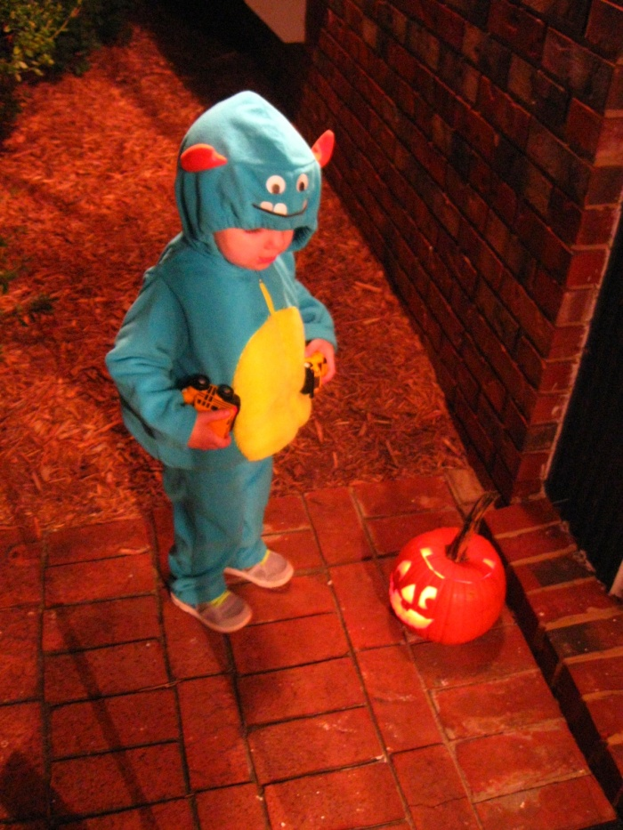 This little blue monster was more interested in the jack-o'-lantern than the candy.