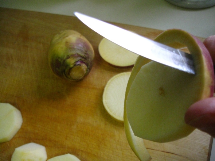 When peeling turnips, make sure to cut off the darker ring beneath the skin, leaving only the white inner flesh to cook with