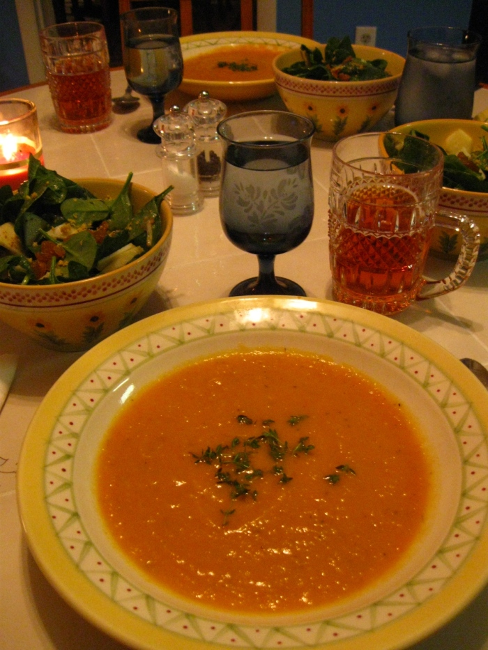The soup, garnished with thyme, takes center stage. The apple theme runs through the whole meal, with apple and spinach salad on the side and a spiced, hard apple cider as the beverage for the evening.